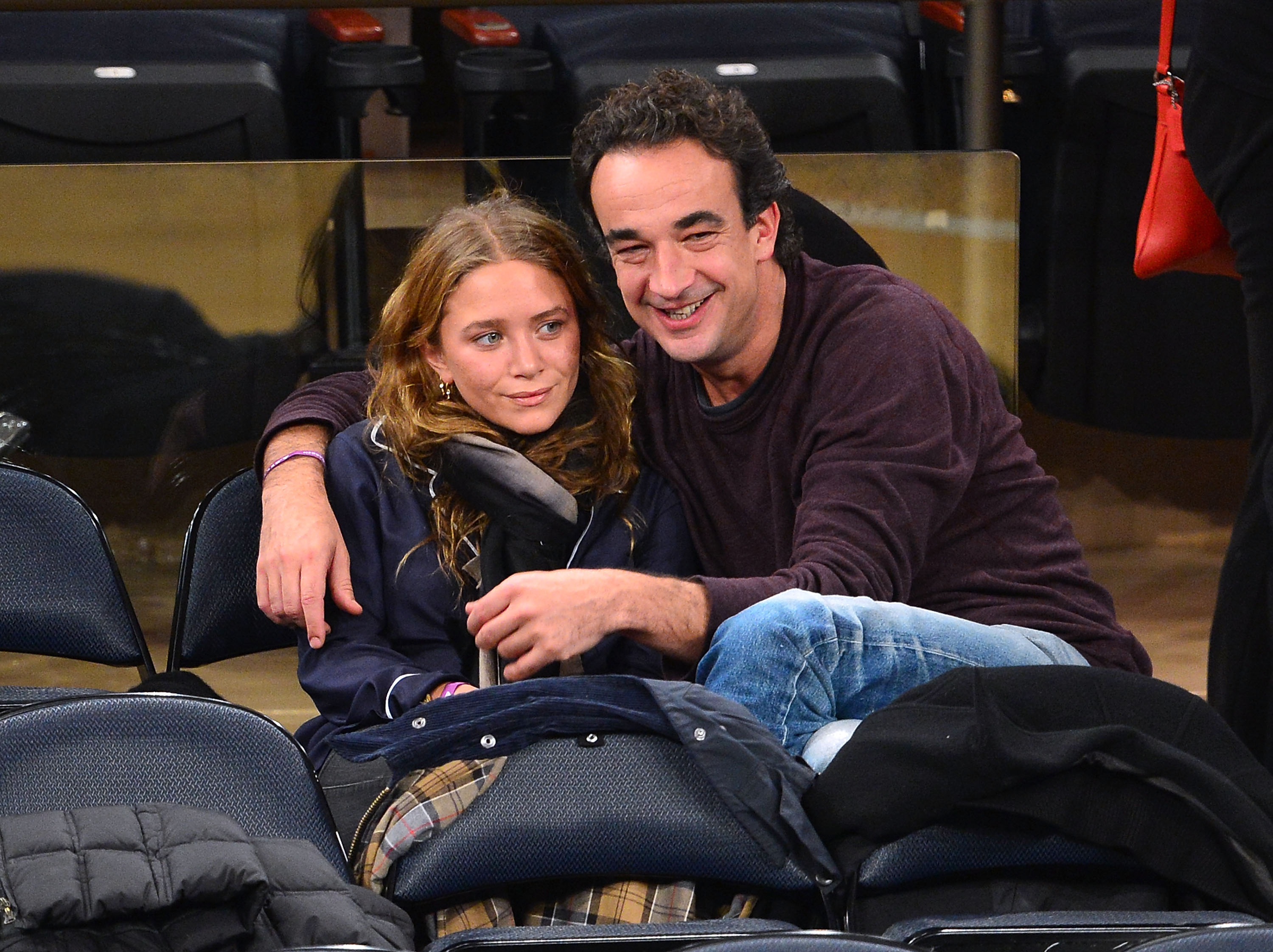 NEW YORK, NY - NOVEMBER 09: Mary-Kate Olsen and Olivier Sarkozy attend the Dallas Mavericks vs New York Knicks game at Madison Square Garden on November 9, 2012 in New York City. (Photo by James Devaney/WireImage)
