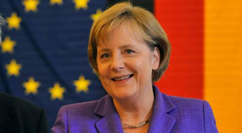 German Chancellor Angela Merkel casts her vote for the European Elections 2009 in a polling station in Berlin, Germany, Sunday June 7, 2009. (AP Photo/Gero Breloer)